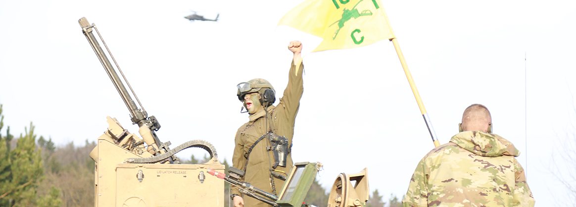 A U.S. Soldier assigned to Charlie Company, 1st Battalion, 18th Infantry Regiment, 2nd Armored Brigade Combat Team, 1st Infantry Division shows enthusiasm before a convoy operation during exercise Allied Spirit VIII, Jan. 25, 2018. Allied Spirit VIII includes approximately 4,100 participants from 10 nations at 7th Army Training Command's Hohenfels Training Area, Jan. 15-Feb. 5, 2018.